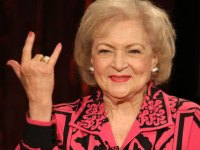 Betty White giving the I love you sign language gesture