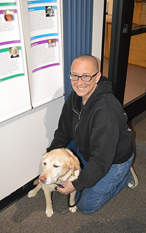 """Ripley and me near my posting at """"The Wall of Heroes"""" at the PTSD Nation Exhibit in Sacramento."""