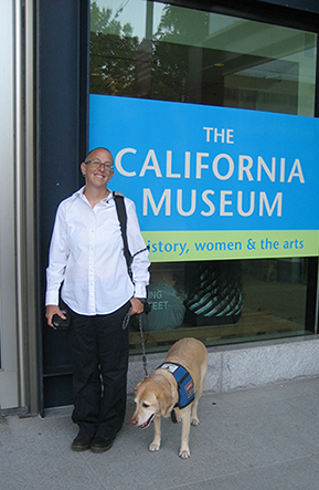 Standing outside The California Museum in Sacramento, host to the Creating Freedom: Art & Poetry of Domestic Violence Survivors exhibit.