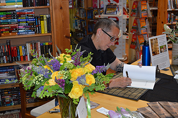A moment of serious signing at the book launch. My wife's cousin and mother-in-law sent the beautiful bouquet from San Diego. So sweet!