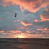 Kiteboarding in Manistee Michigan during sunset