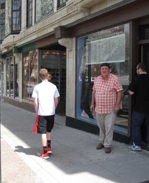 Greg Patterson in front of the block he owns on Broadway.