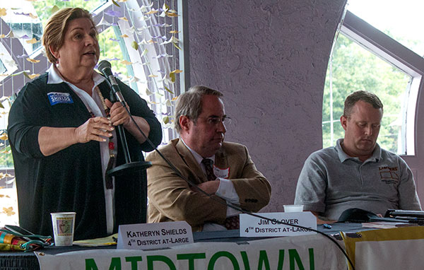 Fourth district council candidates Katheryn Shields and Jim Glover at a candidate forum this week. Jay Hodges, a candidate in the 2nd district, is to their right.