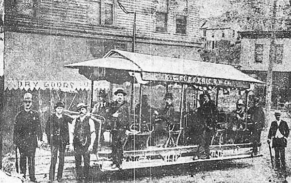John C. Henry, second from the left, is credited for testing the first electric trolley car along Broadway Boulevard in 1884. Henry is seen in this photo, published in the Kansas City Times in 1954, along with the operator of the car, Charles F. Cobleigh, standing on the running board near the front end of the car.