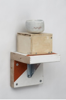 Tom Sachs, American (born 1966). NASA Chawan, 2012. Porcelain with engobe inlay, 2.5 x 3.5 x 3.5 inches. Courtesy of Baldwin Gallery.