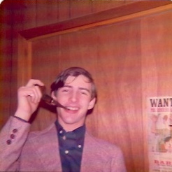 Another Christmas, year unknown, smoking an Avon pipe dispenser of aftershave.