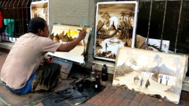 Street artist in Bogota. We bought two of his masterpieces for $10!