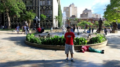 Medellin City Tour - Shawn Reece posing in Botero Plaza.