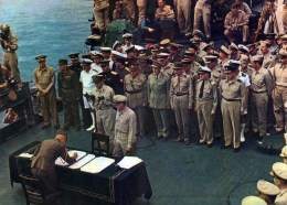 Allied officers look on as Japan signs the official surrender document. Tokyo Bay, Sept. 2, 1945. (Image source: Youtube)