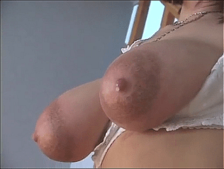 a screenshot of a pair of enormous milk-filled boobs capped with a pair of equally enormous areolas that auto-drip milk
