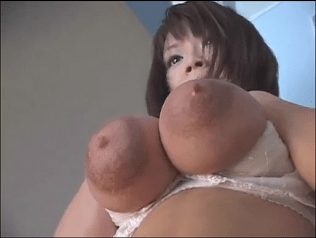 a pair of enormous milk-filled breasts capped by a pair of equally enormous areolas