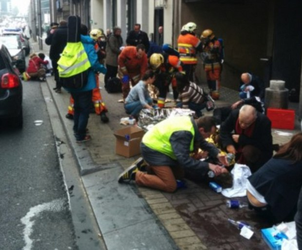 3272CE8400000578-3503928-Bravery_People_are_treated_comforted_and_given_water_by_the_emer-m-7_1458639870116