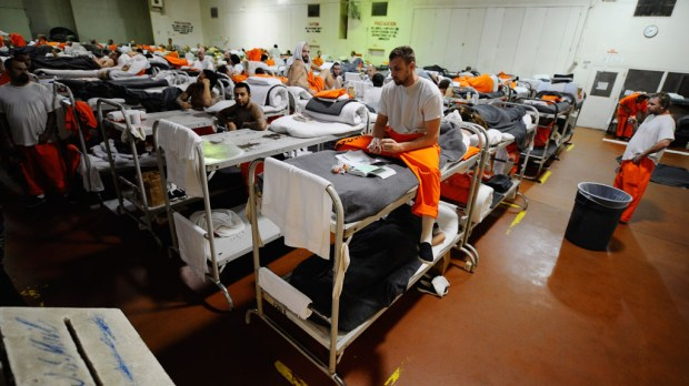 CHINO, CA - DECEMBER 10: Inmates at Chino State Prison, which houses 5500 inmates, crowd around double and triple bunk beds at a gymnasium that was modified to house 213 prisoners on December 10, 2010 in Chino, California. The U.S. Supreme Court is preparing to hear arguments to appeal a federal court's ruling last year that the California state prison system would have to release 40,000 prisoners to cope with overcrowding so severe that it violated their human rights. More than 144,000 inmates are currently incarcerated in prisons that were designed to hold about 80,000. (Photo by Kevork Djansezian/Getty Images)