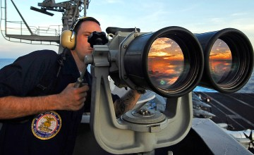 """090408-N-6538W-189 PACIFIC OCEAN (April 08, 2009) Boatswain's Mate Seaman Apprentice Paul Coombs, from Dover, Ohio, uses the """"big eyes"""" to locate surface contacts while standing port forward lookout watch on the island structure aboard t aircraft carrier USS John C. Stennis (CVN 74). John C. Stennis is on a scheduled six-month deployment to the western Pacific Ocean. (U.S. Navy photo by Mass Communication Specialist 3rd Class Walter M. Wayman/Released)"""