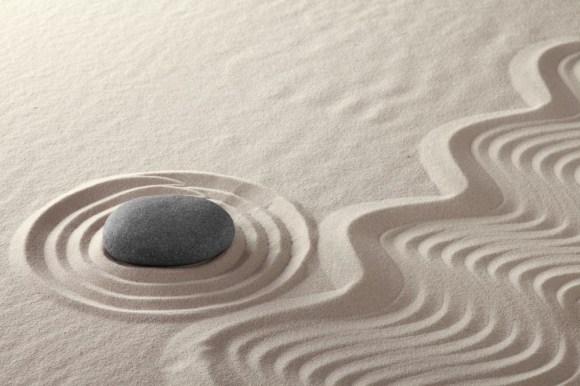 rock garden zen buddhism meditation stone and lines in sand Japanese culture concept for balance simplicity purity and concentration conceptual for spa and wellness background
