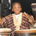 4-year-old-Jaleel-Douglas-plays-his-heart-out-on-drums-during-Kwanzaa-celebration