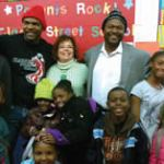 (L-R) Clarke Street School Principal Daryl Burns, AT&T Pioneer Jeanette St. Onge, and AT&T's Dextra Hadnot with students who received donations of winter items from the AT&T Pioneers.