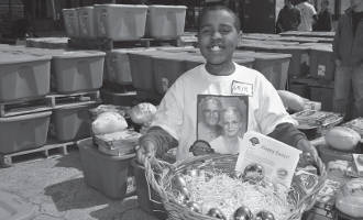 1,500 area families received Easter meals this week from Palermos and The Hunger Task Force's annual event to help needy families.Pictured above is one of the Palermo's volunteers. He's holding a basket of 50 golden Easter eggs, which each contained a $50 bill. These 50 eggs were distributed to 50 Easter basket recipients at random as an extra holiday gift in commemoration of Palermo's 50th anniversary this year.