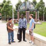 Cameron Webb, center, tours the UWM campus with Thomas Horak (right) and Chianeng Lor. All are students in the School of Architecture and Urban Planning.