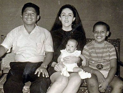 Strange family, strange boy, grinning Barry Soetoro wearing a inverted arm man rune talisman, the symbol of evil and death. We're not in Kansas anymore, Toto.