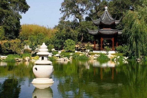 Picturesque Chinese garden design water feature massive rocks - chinese garden design