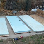 And onto the real work... Making the insulated panels for the skirting.  I just used construction adhesive to glue a piece of riged insulation to some left over OSB I had.