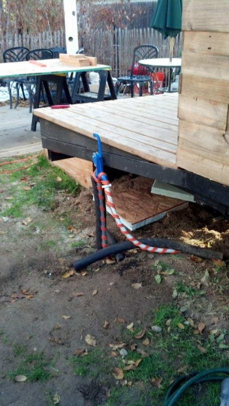 I think I had forgotten to show my water source being heat taped too... so hear that is.  James put in a lawn hydrant for me with the addition of his shop in back, it doesn't sit under the skirted part though so I wrapped it in heat tape and insulation so that is doesn't freeze and break.  It's still new enough that the water is brown coming out but that will get better as I can use it more.  I think it will work well.