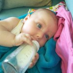 and is starting to hold her own bottle, she justs barely learned about bottles and now shes doing it herself...