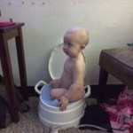 This is going to be one of those embarassing pitures I am going to get in trouble for shaaring later... but its funny/adorable.  She 'sorta' gets how the potty works... :)  We are teaching about potties and she has been successful a few times :)