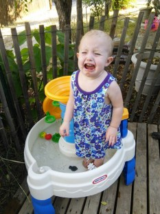 Hazel got stuck in her water table, she LOVES her water toy in the heat we've had, she rubs the water in her hair to cool down, then climbs up in it, gets stuck adn cries for help down... and mom gets out her camera :)