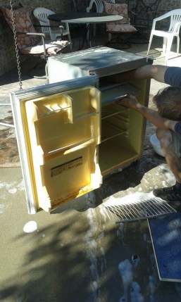 And the kicker, this is a propane/electric fridge that I had reclaimed for my tiny house but didn't end up using. Purely by chance I saved it, we tested, it works great! the obnoxious yellow is actually one of our accent colors so it will be ok! the front is a sticker to make it look like dark wood... that will be updated but having a working fridge saves us a bunch. The camper only came with an ice box originally!