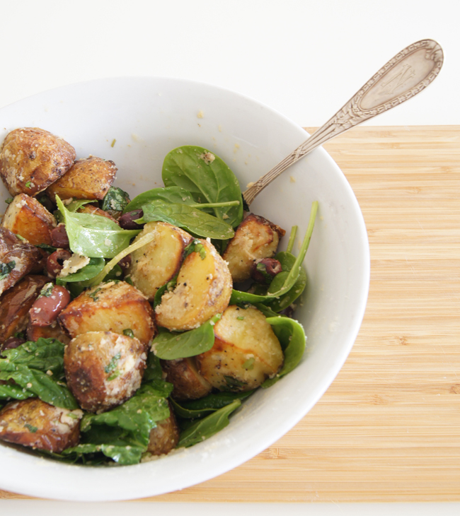 Parmesan Tossed Roast Potatoes with Kalamon Olives, Capers and Spinach