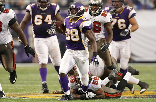 Photo of Adrian Peterson Rushing Against The Tampa Bay Buccaneers