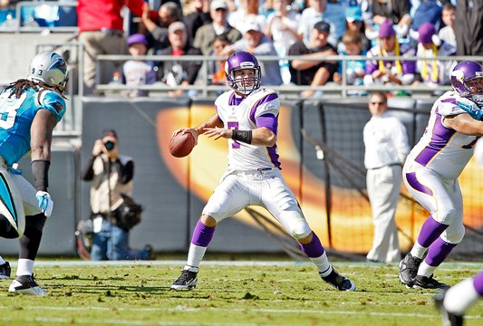 Photo of Christian Ponder throwing a pass against the Carolina Panthers