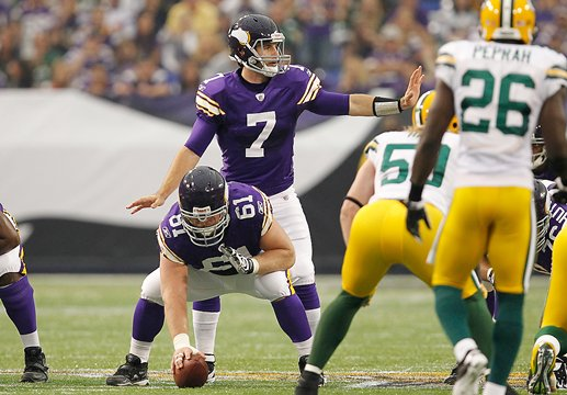 Photo of Christian Ponder calling out plays against the Green Bay Packers