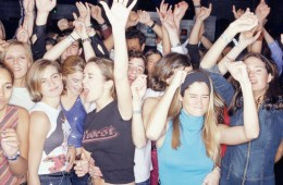 Large group of teenagers dancing at club, front view