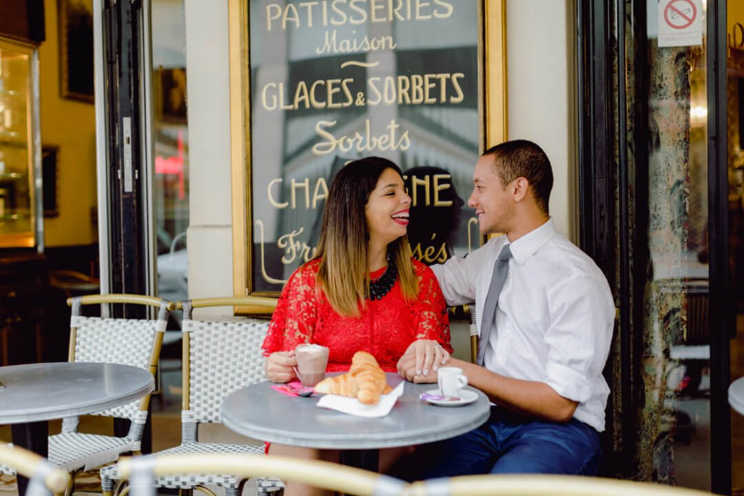 Catering Manager with Fiance Sharing Espresso in Paris Bistro