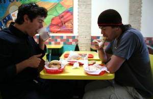 Ryan Fox and Kyle Overstreet polish off a Farolito lunch, in Oakland's Fruitvale neighborhood.