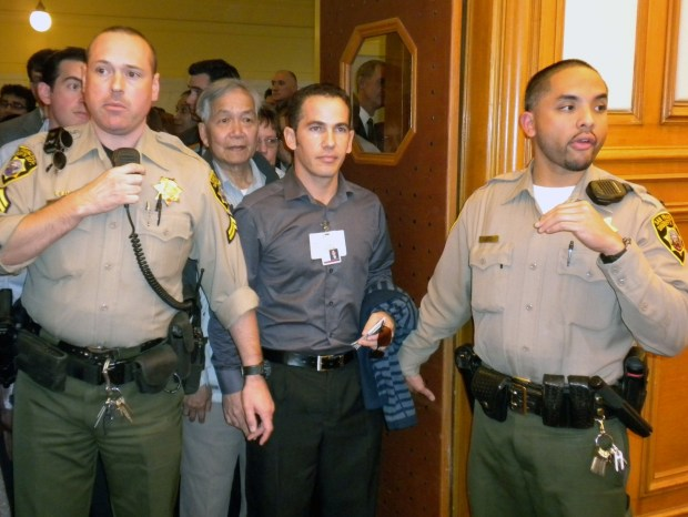 Sheriffs regulate entry into the Planning Commission meeting on Thursday.