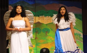Two young singers rehearse at the Community Music Center for La Posarelas play.