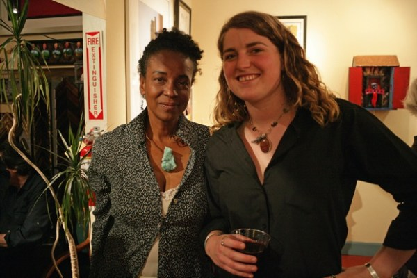 On the right, Jennie Allida Dickerson and her friend wearing Jennie's artwork, elaborated metal and stone jewelry.
