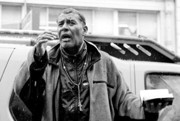 A street preacher speaks out in the rain