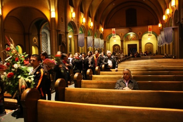 At the end of the service, people brought their gifts up to the altar.