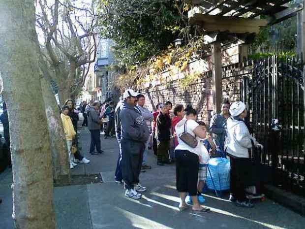 People line outside Saint John Episcopal church to get into the Julian Pantry