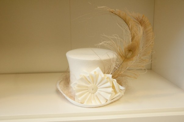 White miniature top hat with veil and feathers by Tricia Roush at House of Nines.