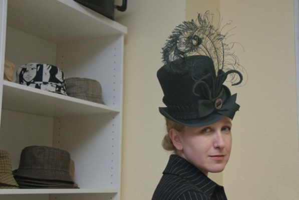 Elina Tachkova in miniature black felt top hat by Tricia Roush of Houses of Nines at ADS Hats.