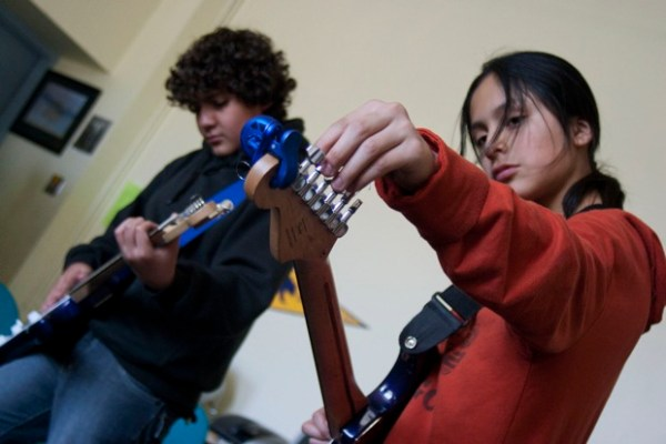 Daniel Lopez, 13, and Amadeos Oyagata, 13, tune up for a rehearsal lesson.