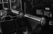 Maria de la Mora, right, on the 9-San Bruno waiting to connect with two more buses on her morning work commute.