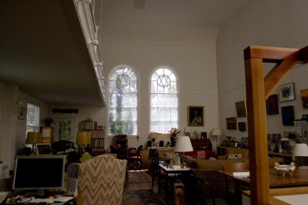 In the Middiones' space, the collections of a lifetime have room to be enjoyed. The upstairs bench was the women's balcony during the time of the Orthodox synagogue.