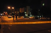 Police keep the area closed where the shooting occurred outside of Valencia Gardens on Guerrero.